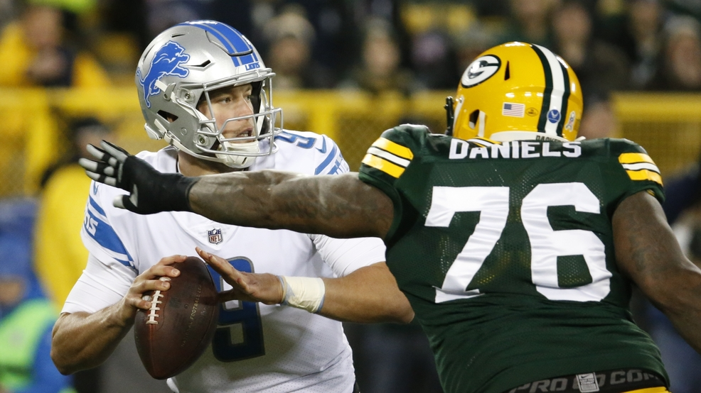 0b2c9a6b93a Detroit Lions  Matthew Stafford drops back with Green Bay Packers  Mike  Daniels rushing during the first half of an NFL football game Monday