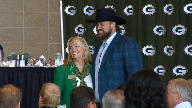 fca7d9236ad71 VIEW ALL PHOTOS. Green Bay Packers quarterback Aaron Rodgers enters the Welcome  Back Packers luncheon dressed in western ...