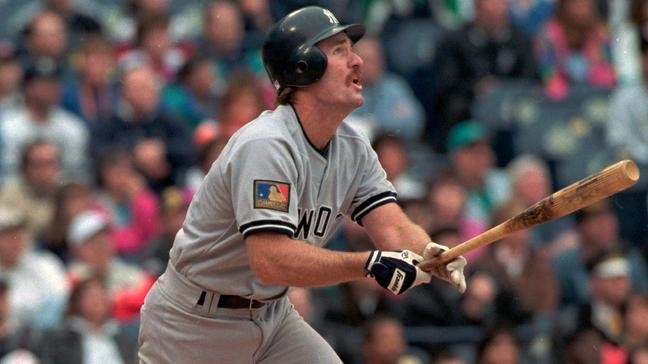 3945c2129 In this May 14, 1994, file photo, New York Yankees' Wade Boggs wears Major  League Baseball's 100th anniversary patch as he follows the flight of his  ninth ...