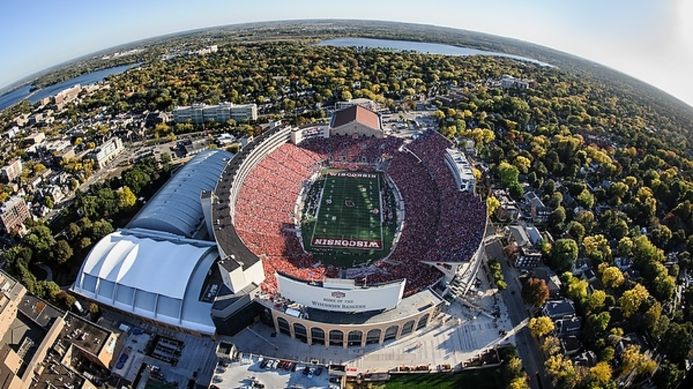 innovative design a0255 66a1b A sea of red-attired fans fill Camp Randall Stadium at the University of  Wisconsin-Madison as the Wisconsin Badgers play during a football game on  Oct. 12, ...